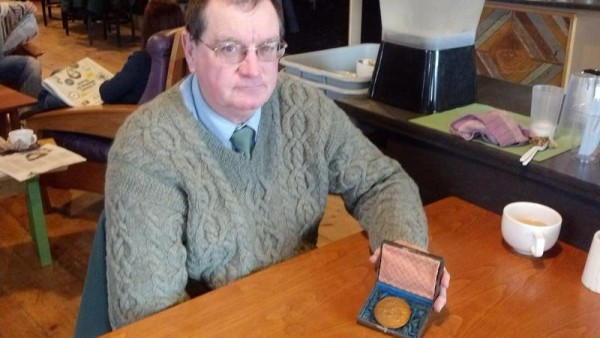 Richard Fitzgerald shows off the medal that will be presented to a West Coast museum honoring the USS Hornet.