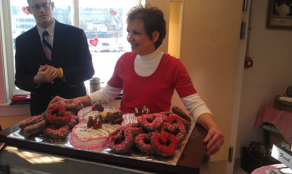 Elaine Poulin, owner of Elaine's Cafe and Bakery in Milo, offers up a plate of heart-shaped doughnuts during a celebration of the opening of the Milo Heritage Building on Thursday, Feb. 14, 2013. The building was built on a downtown lot that was ravaged by fire in 2008.