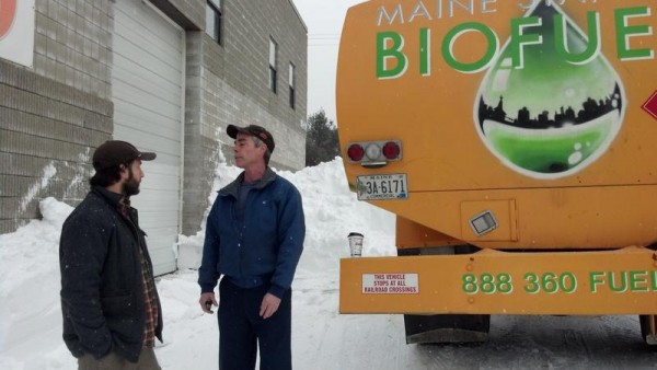 Maine Standard Biofuels President Jarmin Kaltsas, left, checks on a supply of heating fuel going out for delivery with driver Joe Kilmartin.
