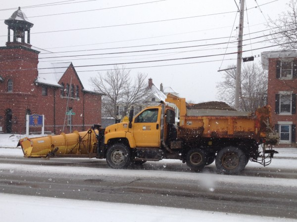 A plow truck is driven on State Street in Bangor on Friday morning, Feb. 8, 2013.