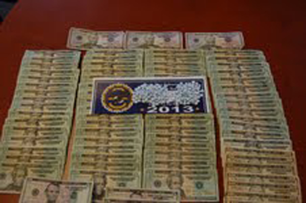 About 200 oxycodone tablets and $1,550 in cash were seized Tuesday by police in Rockland.