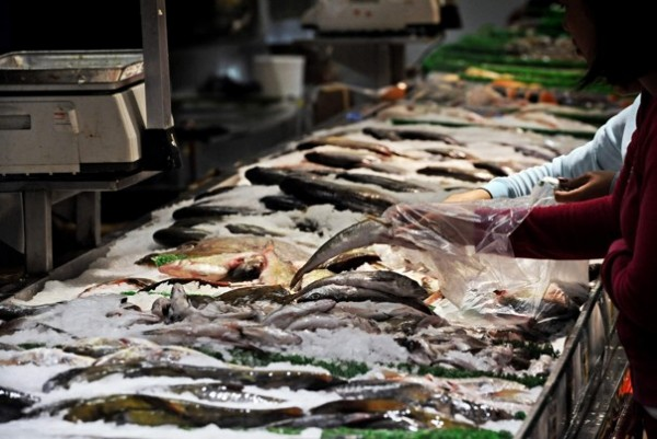 Customers select their own fish at a supermarket in this 2012 file photo. As much as one-third of seafood sold in restaurants and grocery stores is fraudulently labeled, according to a new report.