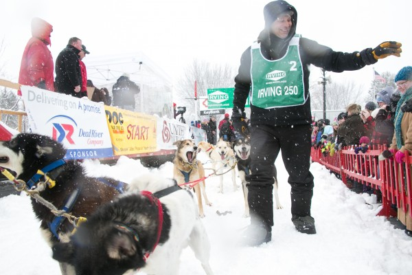 Martin Massicotte of St-Tite, Quebec, Canada waves to the crowd before checking his team one final time at the start of the Can-Am Crown 250-mile dog sled race in Fort Kent on Saturday, March 2, 2013.