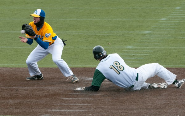 Husson's Shawn Smith, right, steals second base as University of Maine-Presque Isle's Justin Bergeron takes a late throw during the first game of their doubleheader on Saturday, March 23, 2013.