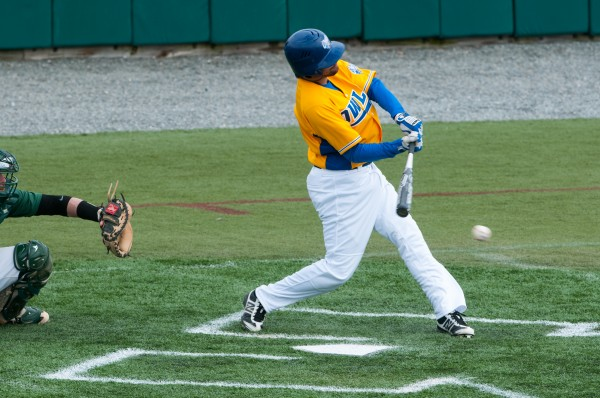 University of Maine-Presque Isle's Stephen Thorne swings at a pitch during the first game of a doubleheader against Husson on Saturday, March 23, 2013.