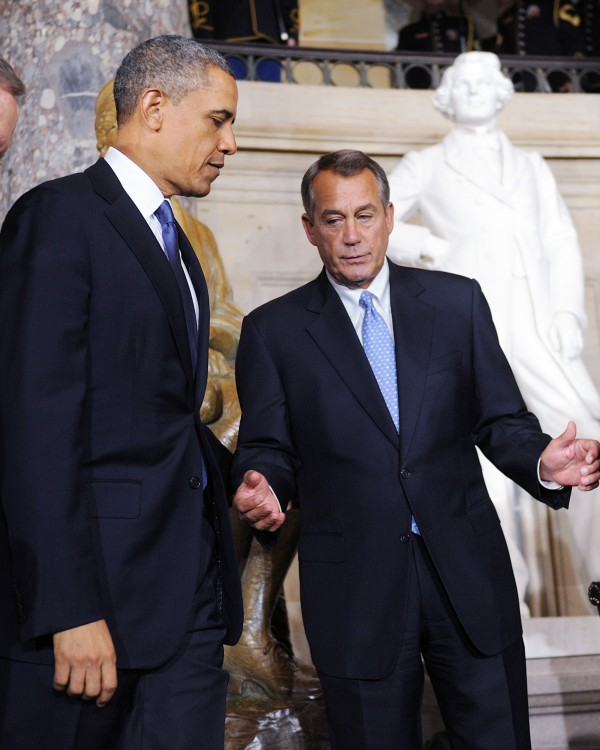 President Barack Obama and Speaker of the House John Boehner look on after unveiling the statue of Rosa Parks at the United States Capitol in February.