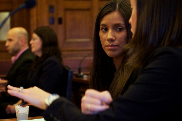 Alexis S. Wright, 29, of Wells listens to her attorney, Sarah Churchill in Cumberland County Superior Court Tuesday Oct. 9, 2012, when she was arraigned on 106 criminal charges.