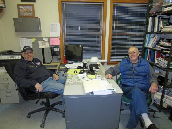 Retiring Bowdoinham Fire Chief Jack Tourtelotte and his predecessor, Allan Frizzle, confer in Tourtelotte's office Monday night during the department's weekly training. Between them, they have led the Bowdoinham Fire Department for 49 years.