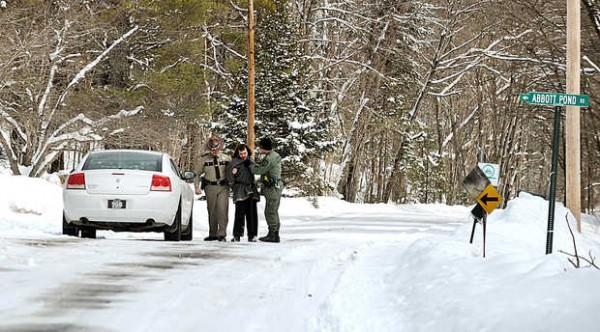 Oxford County Sheriff's Sgt. Timothy Ontengco (left) and Deputy Michael Halacy arrest Benjamin Stewart, who was charged with threatening Richard Pothier when he attempted to plow Abbott Pond Road in Sumner on Wednesday. The dispute stems from an argument between the Pothier family and Nicole Lutz, Stewart's mother, over who owns and has the right to use Abbott Pond Road.