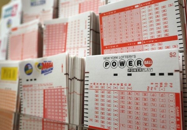 Cards for lottery customers to pick their own numbers are stacked on a rack at a store where people buy tickets for the Powerball lottery in New York, November 28, 2012.