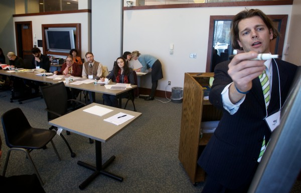 Criminal defense lawyer Merritt Heminway conducts mock court procedures during a training session for interpreters in Portland recently.