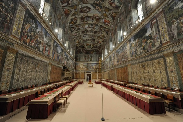 The Sistine Chapel is seen prepared with tables where cardinals will sit when the conclave begins, in a picture released by Osservatore Romano at the Vatican on Tuesday, March 12, 2013. Roman Catholic cardinals will begin a conclave Tuesday afternoon to elect a successor to Pope Benedict XVI, who abdicated last month.