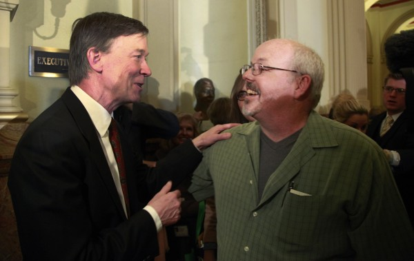 Tom Sullivan (R), whose son Alex was killing in the Aurora movie theater shootings, thanks Colorado Gov. John Hickenlooper after a news conference in Denver March 20, 2013.  Hickenlooper earlier in the day signed three gun control bills into law including one banning ammunition magazines with more than 15 rounds.