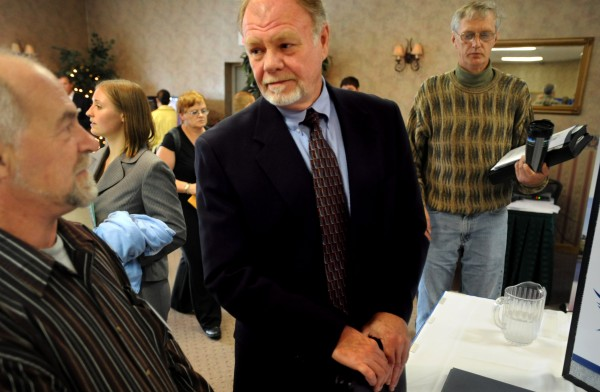 A prospective employee speaks with a prospective employer at a Bangor job fair in this 2008 file photo. U.S. employers added 236,000 jobs in February, pushing the unemployment rate to a four year-low.