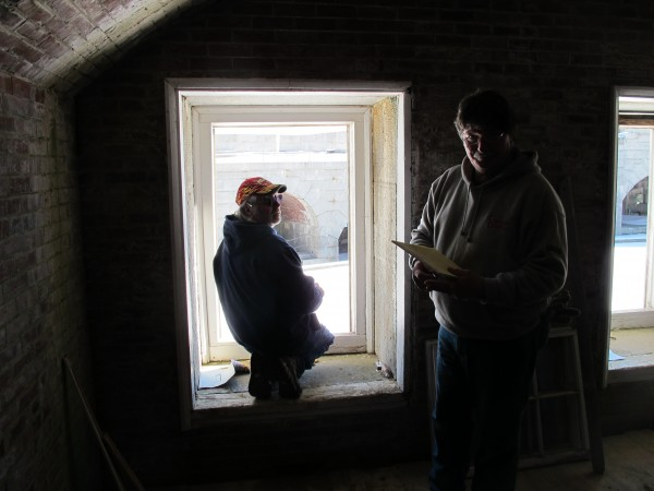 Workers from R.L. White & Son of Hulls Cove work at one of the windows slated for replacement in the Enlisted Men's Quarters at Fort Knox in Prospect, Feb. 26, 2013.