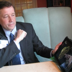 Stephen Bowen, the commissioner of the Maine Department of Education, displays an iPad science app during a conference in Augusta in 2011.