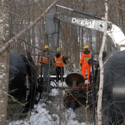 Workers removing oil from cars after train derails near Penobscot River