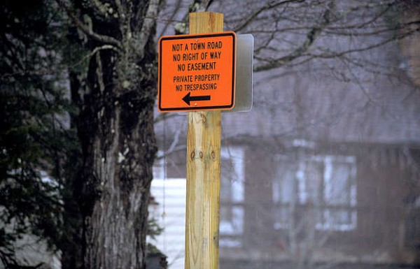 The Lutz family, whose home is in the background, erected a sign at the intersection of Redding and Abbott Pond roads in Sumner warning users of Abbott Pond Road that it is a private road.