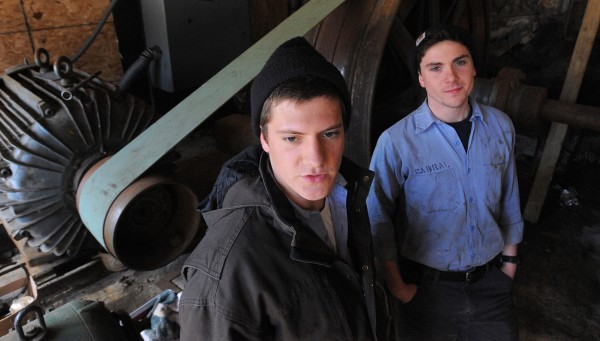Maine Maritime Academy students Nicholas Berner (left) and Nicholas Cabral stand at the Goose River Hydro Co. Powerhouse in Belfast.