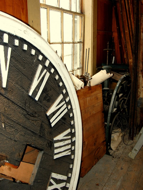 A second-floor storage room of the Cherryfield Academy houses artifacts of times past, including the face and and antique mechanisms of what once served as the Washington County community's town clock.