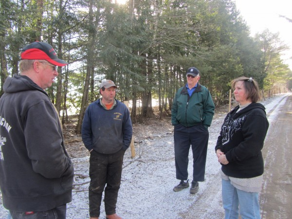 Victoria Burbank (right) speaks with town officials Saturday morning along her property on Goose Hill Road in Jefferson. Meeting with her were Road Commissioner Alan Johnston and Selectmen Gregory Johnston and James Hilton.