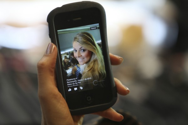 A model looks at her cellphone on March 7, 2013.