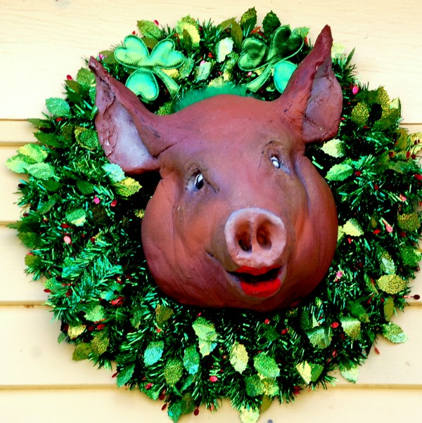 Happy St. Porky's Day! The ceramic porcine that overhangs the front door of the Gouldsboro home of Rick and Beverly Henion on West Bay Road was decked out this weekend for the upcoming St. Patrick's Day holiday. The porker's bling changes with the seasons. A Santa hat was replaced in late January by a Valentine's Day ensemble, which gave way to the wearing o' the green. When hunting season arrives, the pig sports a blaze orange hat. When flu season arrives, a surgical mask. This coming Easter? Who knows?
