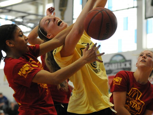 The West's Marissa MacMillian has the ball stripped from her by the East's Danae Johnson with assistance from Jordan Knowton during the class A/B McDonald's All-star basketball game at Husson University on Saturday. The East won 119-66.