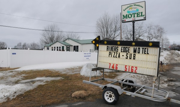 State police searched several rooms at the River's Edge Motel in Medway on Tuesday in connection with the death of 68-year-old Lawrence Lewis, who was found dead at his home at his Macwahoc Road home in Molunkus on Monday.
