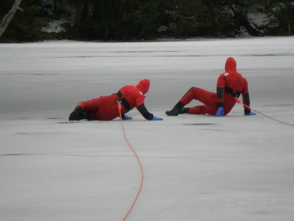 Bath firefighters Mike Drake (left) and Mike Brochu train to become cold water rescue technicians Monday on Whiskeag Pond in North Bath.