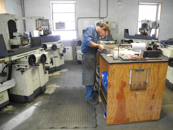 A craftsman works at the Lie-Nielsen Toolworks machine shop in Warren to fabricate one of the company's high-end hand tools.