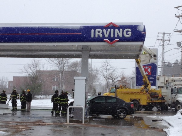 A car hit and knocked over a gas pump at the Irving gas station on Broadway in Bangor on Monday, March 4, 2013.
