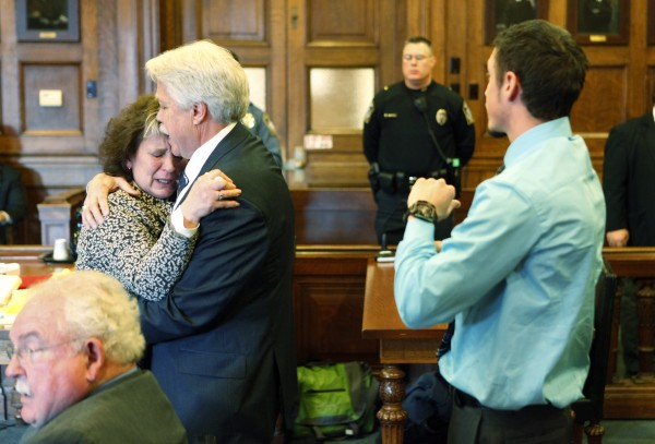 Mark Strong Sr. comforts his wife, Julie, after she became emotional while addressing Justice Nancy Mills during Strong's sentencing at Cumberland County Superior Court in Portland on Thursday, March 21, 2013.