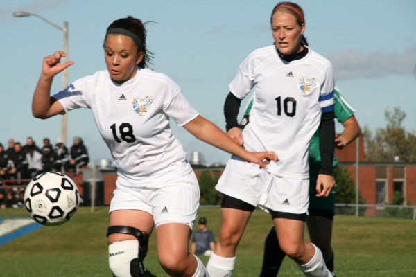 Audra Kirk (left) and Lainey Herring of the University of Maine-Presque Isle women's soccer team chase down the ball during a game last fall. Next season, the Owls will compete for a spot in the NCAA Division III Championship as a member of the Great South Athletic Conference, which is based in Georgia.
