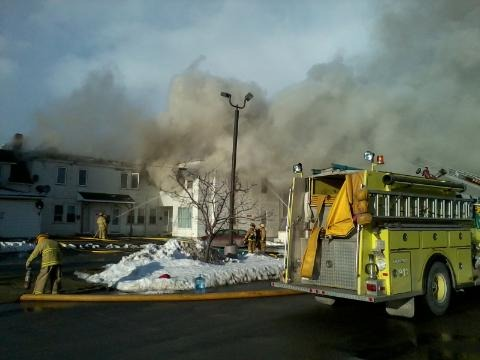 An fire Sunday night heavily damaged a Main Street apartment complex in Presque Isle, leaving 10 residents homeless.