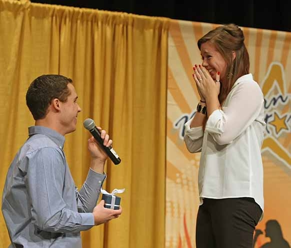 Drew Farrar, of Hodgdon proposed to his girlfriend, Haley Kuschman of Illinois, during the Northern Star singing competition on Sunday, March 3, 2013, at the Houlton Community Arts Center.