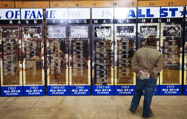 Danny Chasse of Millinocket looks at Maine Basketball Hall of Fame pictures and names while at the Bangor Auditorium on Saturday for a shoot-around fundraiser. Past high school basketball stars and their families showed up to relive past glory days.