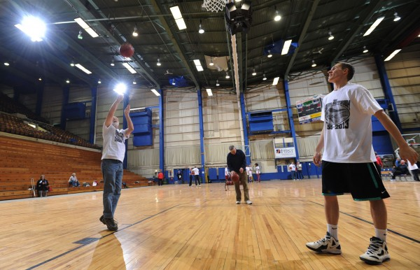 &quotThis is my new range,&quot Bill Colbath (left) said as he and Bangor High School student-athlete Alik Espling shoot hoops at the Bangor Auditorium on Saturday during a fundraiser for the Maine Basketball Hall of Fame. Past and present high school basketball stars and their families showed up to relive past glory days.