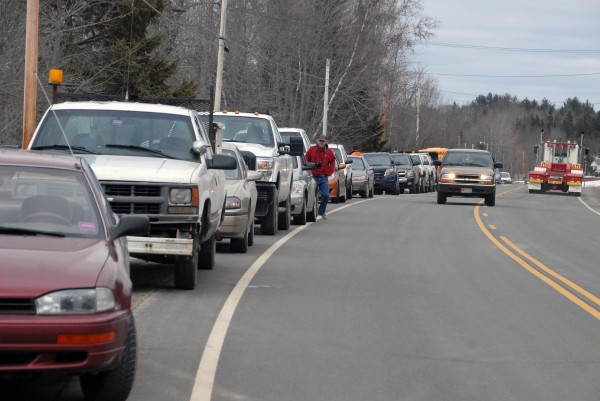 The vehicles of emergency responders and Pan Am Railways Co. workers line Route 2 in Mattawamkeag, the site of a train derailment, on Thursday, March 7, 2013.