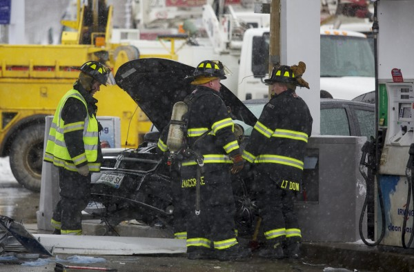 Bangor fire crews work to remove a vehicle that collided with a gas pump at the Circle K gas station on Broadway on Monday morning. The driver was taken to a Bangor hospital with non-life threatening injuries.