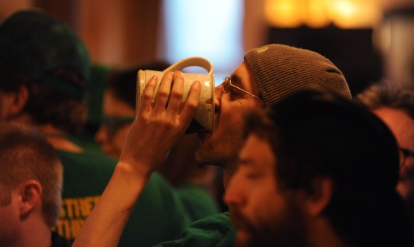 A patron at Paddy Murphy's finishes his drink shortly after 6 a.m. Sunday, St. Patrick's Day.