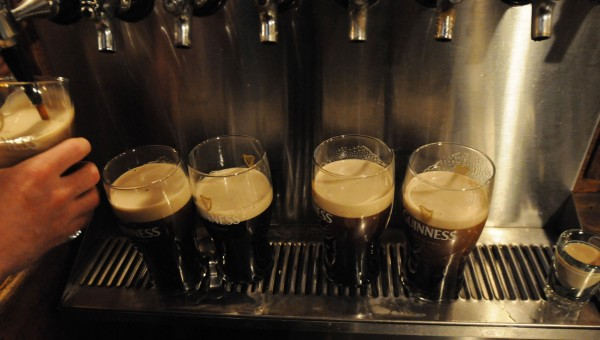 Guinness beer sits on the bar at Paddy Murphy's early Sunday, waiting for the second part of a two-part pour process from bartender Chris Rudolph after 6 a.m. Sunday, St. Patrick's Day.