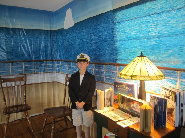 On April 15, 2012, the 100th anniversary of the sinking of the Titanic, Nathan Carey, 8, takes a moment before guests arrive to pose for a photo in his living room. Carey held a commemorative party at his home, and gave a fully researched presentation to his guests, dressed as the ship's Captain, Edward John Smith.