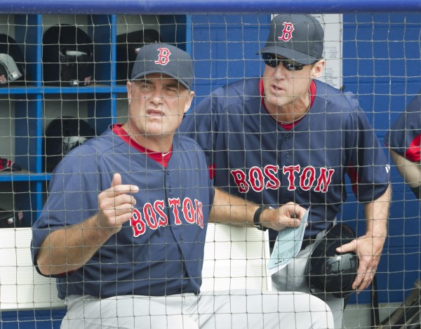 Boston Red Sox manager John Farrell (left) and third base coach Brian Butterfield talk before a spring training game on Feb. 25 in Dunedin, Fla. Butterfield, an Orono native, said he is enjoying his time with his new club after spending the previous 11 years with the Toronto Blue Jays.