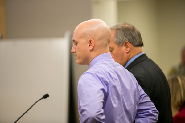 Andrew Weatherbee stands with his lawyer during his arraignment hearing at the Penobscot Judicial Center on Thursday, March 14, 2013.