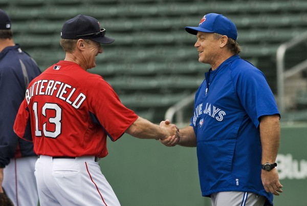 Boston Red Sox third base coach and Orono native Brian Butterfield (left) greets Toronto Blue Jays manager John Gibbons during batting practice before a spring training game on March 12 in Fort Myers, Fla.