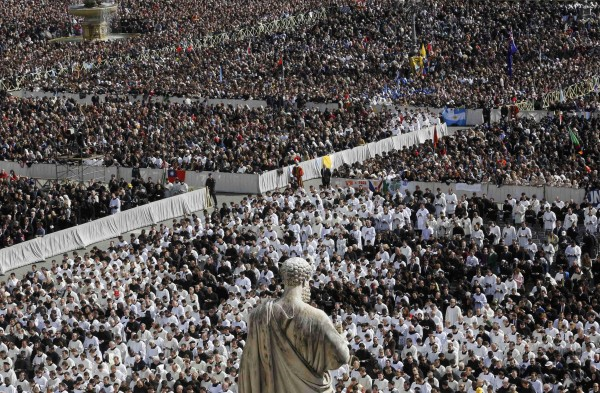 Members of the clergy are seen near a statue of St. Peter during the inaugural mass of Pope Francis in St. Peter's Square at the Vatican, on Tuesday, March 19, 2013.