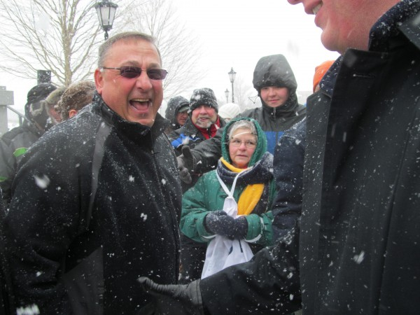 Gov. Paul LePage greets activists at a gun rights rally on Friday, Feb. 8, 2013, outside the State House in Augusta.