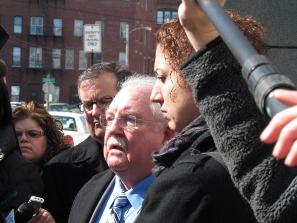 Defense attorneys Daniel Lilley and Tina Nadeau are greeted by reporters and cameras outside the Cumberland County courthouse Thursday, March 21, 2013, after the sentencing of their client, Mark Strong Sr., in the high-profile Kennebunk prostitution case.