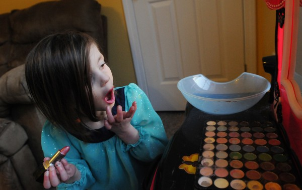 Maggie Rudnicki applies make up at her girl-sized vanity in her parents' living room in Levant on Friday. Her mother Lauren says Maggie taught herself how use make up by watching tutorials on YouTube. Maggie has Diamond Blackfan anemia, a disorder that prevents her body from generating red blood cells. Her brother Lucas will be a bone marrow donor this coming summer, helping her to rid her dependence on blood transfusion every three weeks.
